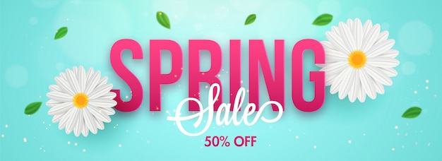 Typographie du printemps avec des fleurs de marguerite