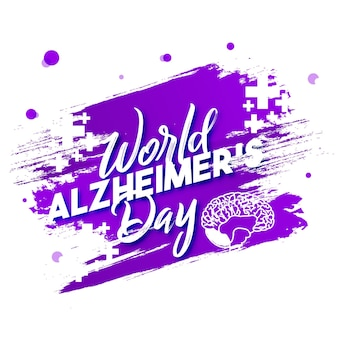 Typographie de la journée mondiale de la maladie d'alzheimer avec l'icône du cerveau sur le patch de brosse