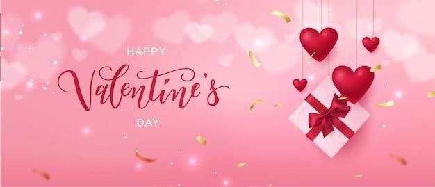 Typographie de lettrage à la main happy valentine's day avec des coffrets cadeaux et des coeurs réalistes.
