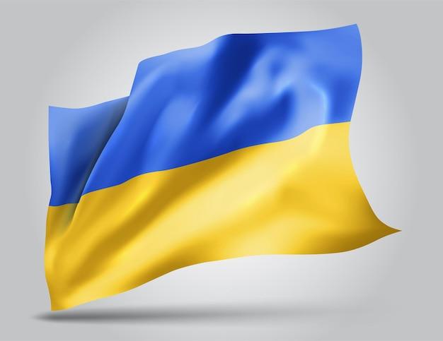 Ukraine, drapeau vectoriel avec des vagues et des virages ondulant dans le vent sur fond blanc.