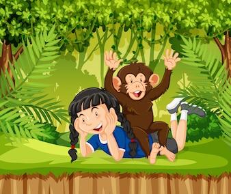 Une fille et un singe dans la jungle