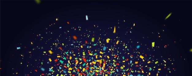 Vacances avec des confettis colorés volants sur dark