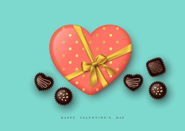 Vacances de la saint-valentin. coeur 3d avec noeud doré et bonbons au chocolat.