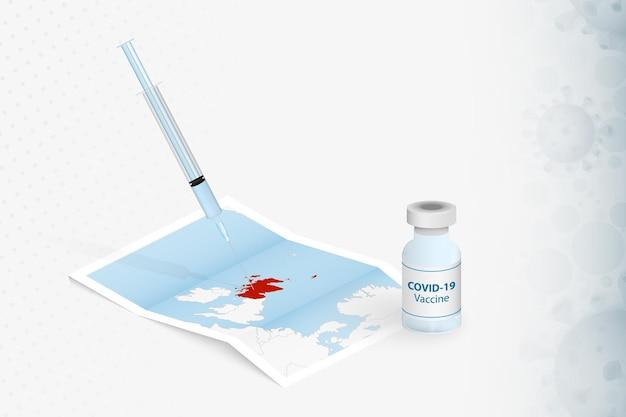 Vaccination en écosse, injection avec le vaccin covid-19 sur la carte de l'écosse.