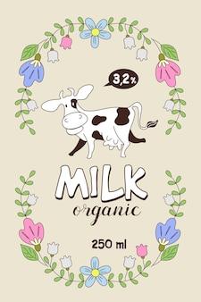 Vache drôle dans un cadre de fleurs sauvages.