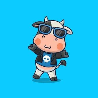 Vache mignonne un dessin animé rockstar isolé sur bleu