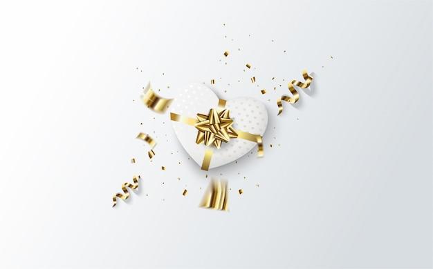 Valentine avec une illustration d'une boîte cadeau en forme d'amour blanc et un ruban d'or sur un blanc.