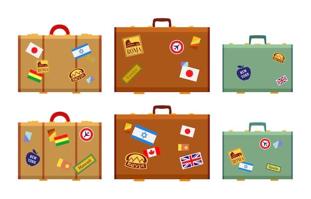 Valises de voyageurs avec les autocollants