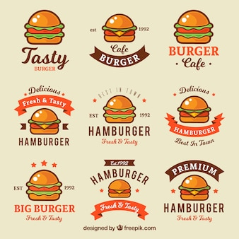 Variété de logos plats avec hamburgers colorés