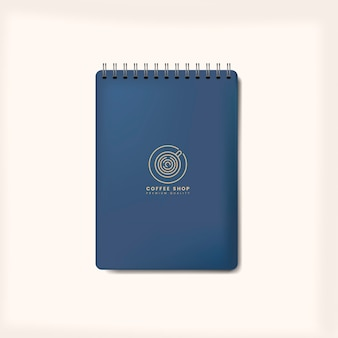 Vecteur isolé maquette de cahier bleu en spirale