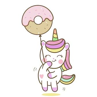 Vecteur de licorne mignon tenant le ballon donut