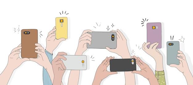 Vecteur de mains prenant des photos avec un smartphone