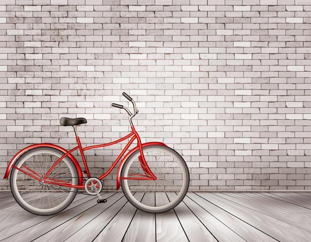 Vélo devant un mur de briques grises.
