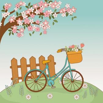 Vélo avec panier de fleurs et clôture dans le paysage