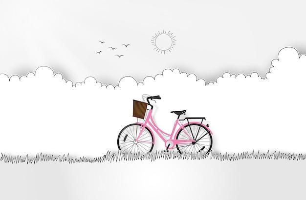 Vélo rose dans le jardin. papier découpé et style de dessin à la main.