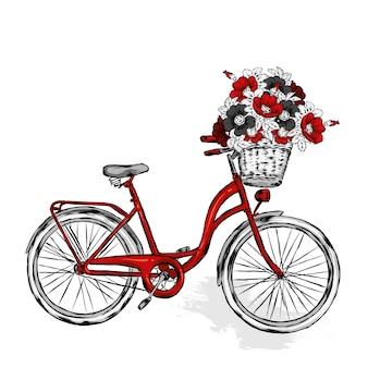 Vélo vintage avec panier avec des fleurs de rose, de rose sauvage et de pivoines.