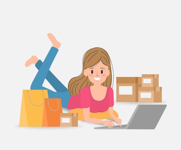 Le vendeur prépare la livraison en ligne ou le commerce électronique.