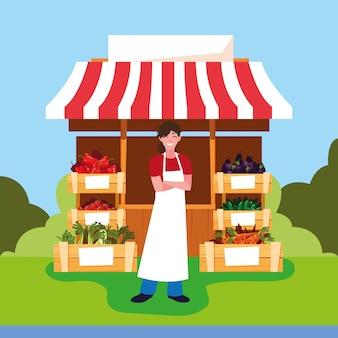 Vendeur avec stand kiosque de magasin de légumes