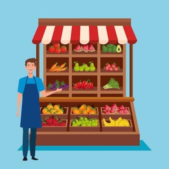 Vendeur avec tablier et fruits et légumes frais
