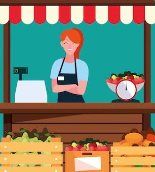 Vendeuse avec stand kiosque façade de magasin de fruits
