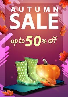 Vente d'automne, bannière verticale discount avec smartphone, bottes de caoutchouc et citrouille