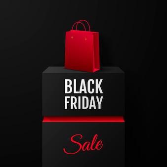Vente du vendredi noir. bannière promotionnelle sur colonne carrée noire avec sac de produit.