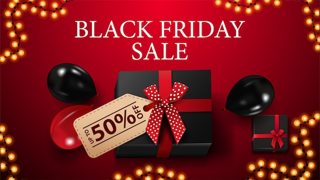 Vente du vendredi noir, jusqu'à 50% de réduction, bannière de réduction rouge avec cadeau noir avec étiquette de prix avec offre, cadre de guirlande et ballons rouges et noirs, vue de dessus