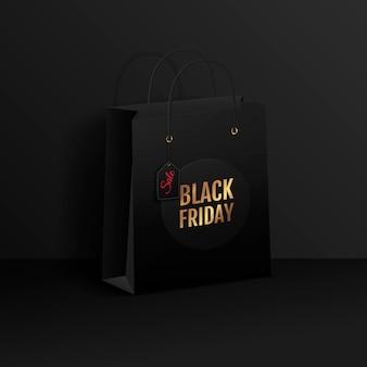 Vente du vendredi noir. sac à provisions noir sur fond sombre.