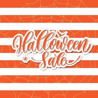 Vente d'halloween - carte de lettrage à la main.