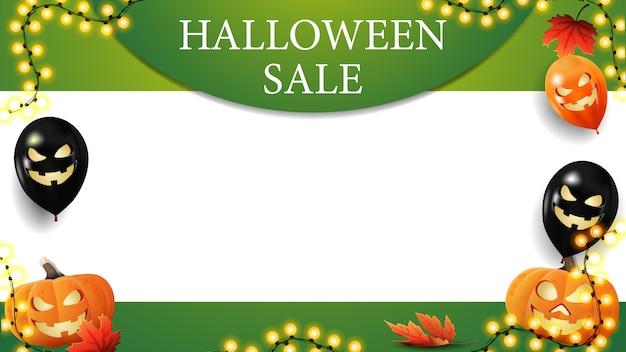Vente halloween, modèle horizontal vert pour vos arts avec espace de copie. ballons d'halloween, guirlande et citrouilles