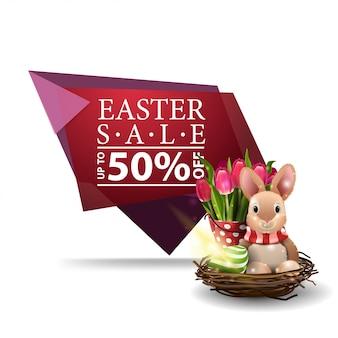 Vente de pâques, bannière rose avec le lapin de pâques et les tulipes