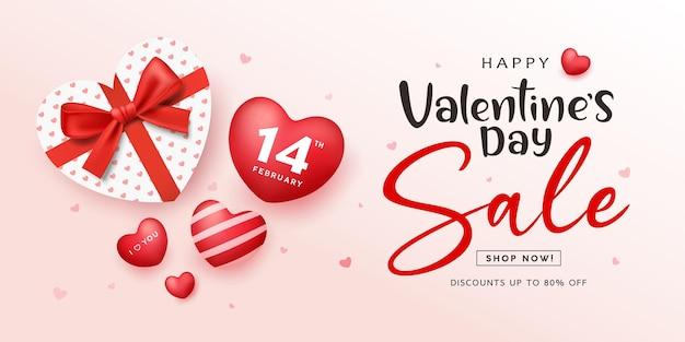 Vente de la saint-valentin, boîte-cadeau ruban rouge en forme de coeur et coeur