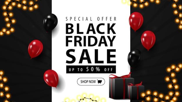 Vente de vendredi noir, bannière web horizontale avec des cadeaux. bannière discount noire avec des ballons