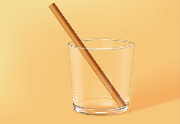 Verre à l'ancienne vide avec de la paille de bambou à l'intérieur