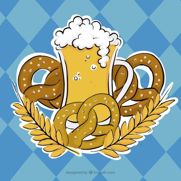 Verre de bière entouré par des bretzels