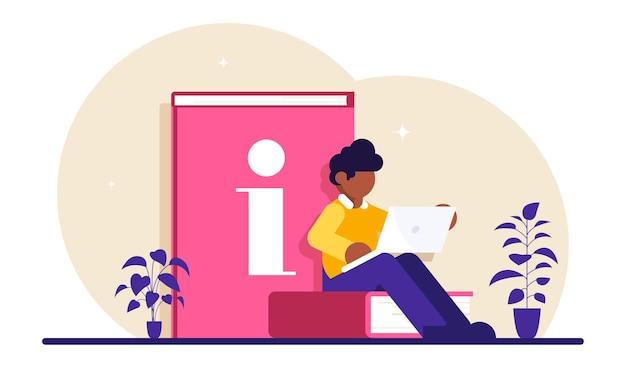 Version des guides en ligne. un homme assis sur un livre étudie des manuels à l'aide d'un ordinateur portable.