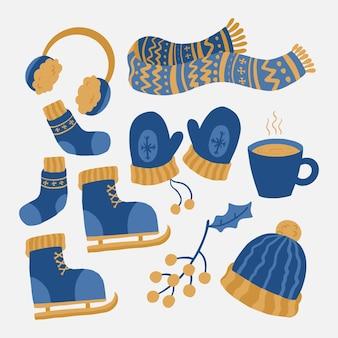 Vêtements d'hiver et essentiels dessinés à la main