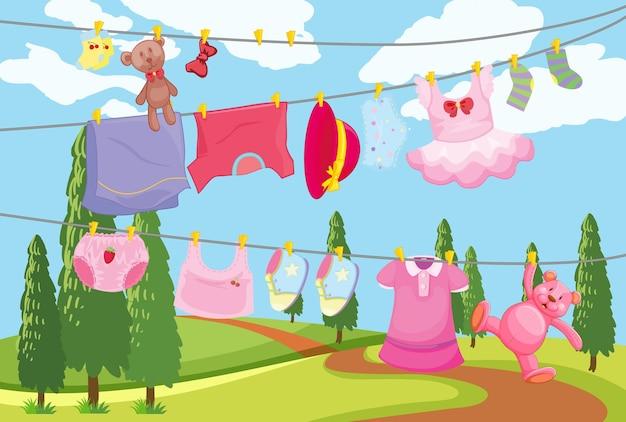 Vêtements pour enfants mignons accrochés à une ligne dans la scène en plein air