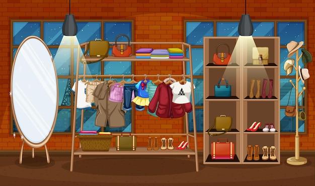 Vêtements suspendus sur un portant avec des accessoires sur des étagères dans la scène de la salle