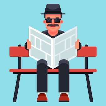 Vieil homme au chapeau lisant un journal