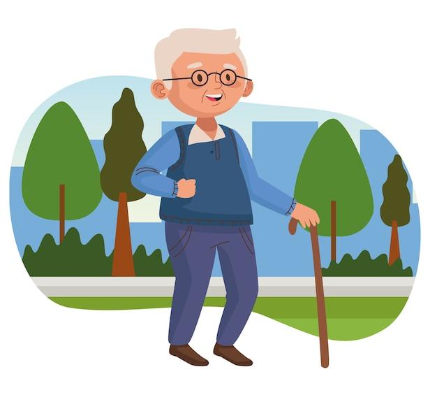 Vieil homme marchant avec canne dans le parc de caractère senior actif