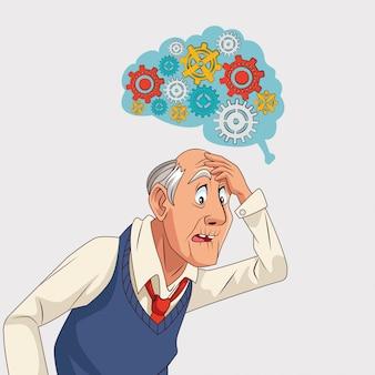 Vieil homme patient de la maladie d'alzheimer avec machine à engrenages