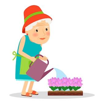 Vieille femme arrosant des fleurs
