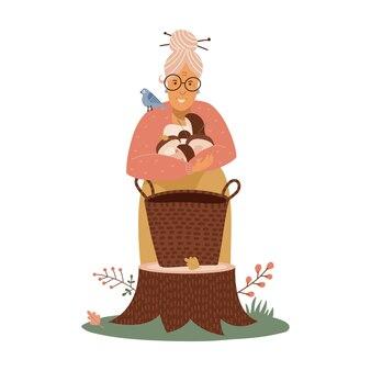 Une vieille femme met les champignons récoltés dans le panier dans le concept de cueillette et de chasse aux champignons forestiers ...