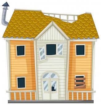 Vieille maison avec des fenêtres cassées