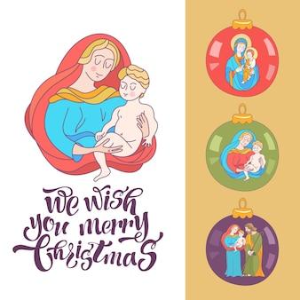 La vierge marie et l'enfant jésus sur une boule de sapin de noël.