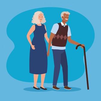 Vieux couple avec des vêtements décontractés et un bâton de marche