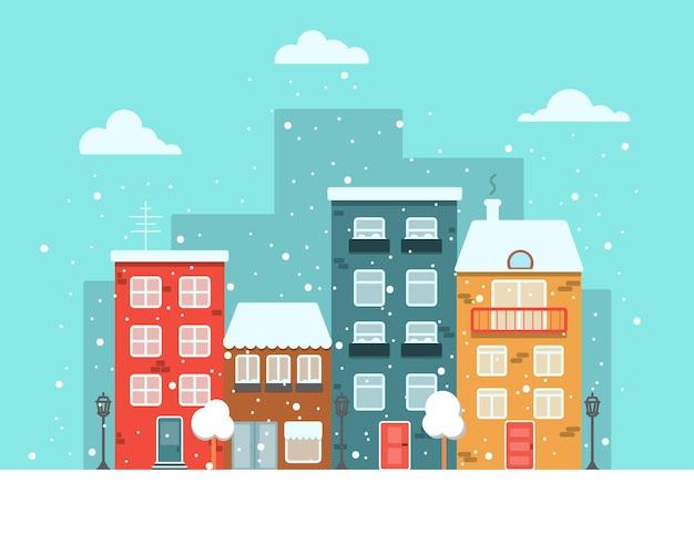 Ville aux maisons colorées au bord de la route en hiver, neige et flocons de neige