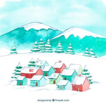 Ville de noël aquarelle avec des montagnes enneigées