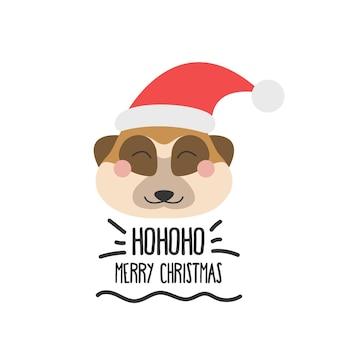 Visage drôle mignon d'un suricate dans un chapeau de santa avec l'inscription joyeux noël